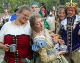 Cast partying at the end of a long day, including the queen in the background, me, Milady de Winter, and King Louis